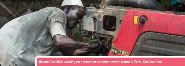 Mallam Abdullahi working on a tractor at a tractor service centre