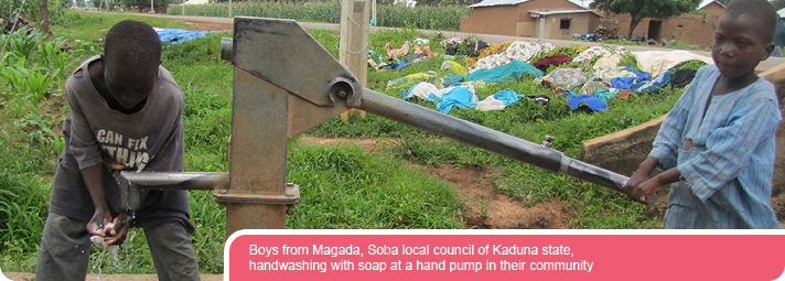 Boys from Magada, Soba local council of Kaduna state, handwashing with soap at a hand pump in their community