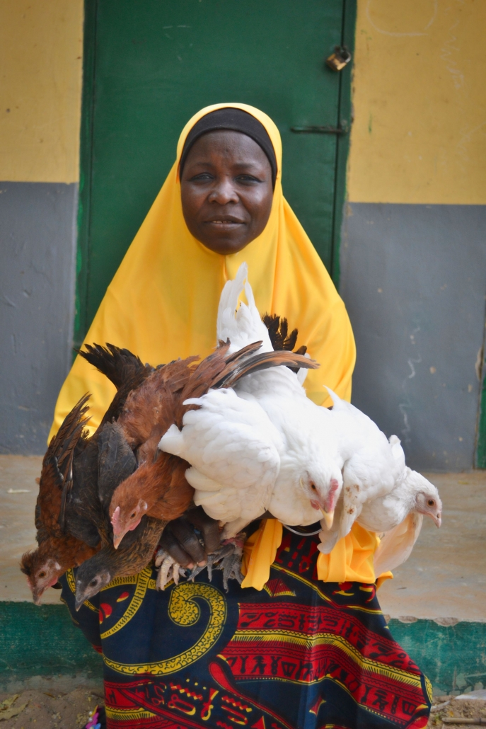 Women Chicken Producers Improve Production with Education and Access to Vaccination.